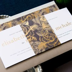 The long horizontal layout makes the Charlotte invitation suite unique. This Luxepress printed collection features a romantic floral pattern with metallic ink highlights. All pieces are printed on matte cardstock