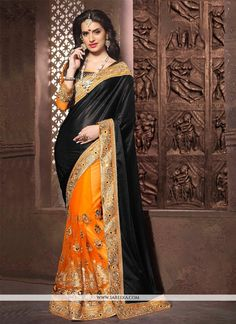 Be the sunshine of everybody's eyes dressed in this lovely black net and georgette designer saree. Beautified with embroidered and patch border work all synchronized properly through the trend and s...