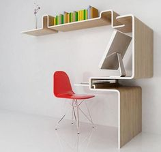 I love the sculptural profile of this desk, and how it continues up the wall to form a bookshelf. Elegant, and it takes up minimal floor space.