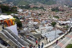 A huge outdoor escalator has been erected in one of the poorest districts of Colombia's second largest city.For generations 12,000 people living in Medellin's tough Comuna 13 - which clings to a hillside - have had to made the arduous journey up hundreds of large steps, which is the equivalent to climbing up a 28-storey building.But now a giant outdoor escalator will cut their journey from 35-minutes to just six, and grateful residents have said 'it is a dream come true'.