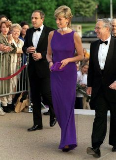 Diana, Princess Of Wales, Looking Pensive As She Leaves A Gala Dinner Held At The Field Museum Of Natural History. The Princess Is Wearing A Purple Evening Dress Designed By Versace. Get premium, high resolution news photos at Getty Images Princess Diana Dresses, Princess Diana Fashion, Princess Diana Family, Princess Diana Pictures, Princess Of Wales, Princess Diana Biography, Lady Diana Spencer, Glamour, Royal Fashion