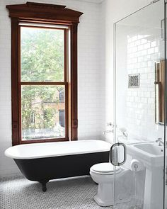 honey cone tiles, black tub and victorian window