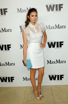 Nina Dobrev looked sweet in a white dress.