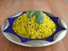 Recipe for Lemony Saffron Couscous, a savory side dish with lemon, chickpeas, pine nuts and cilantro. Kosher, Meat or Pareve, Vegan option.