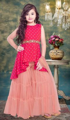 This Red Fancy Fabric Embroidered Kids wear is perfect for your kid. Kids Party Wear Dresses, Baby Girl Party Dresses, Dresses Kids Girl, Long Frocks For Girls, Stylish Dresses For Girls, Pakistani Kids Dresses, Pakistani Dress Design, Baby Frocks Designs, Kids Frocks Design