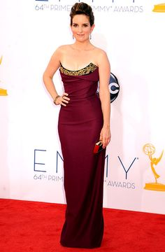 The 30 Rock star stunned in a burgundy, corseted Vivienne Westwood number and Fred Leighton jewelry.        Read more: http://www.usmagazine.com/celebrity-style/pictures/2012-emmys-what-the-stars-wore-2012239/25128#ixzz2AIa5zDwm