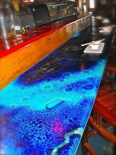 Color fuse glass counter top by Gomolka Design Studio