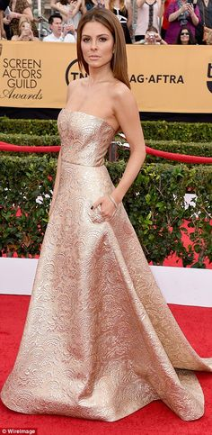 Golden girl: Maria Menounos wore a glamorous gown to help host E!'s red carpet coverage