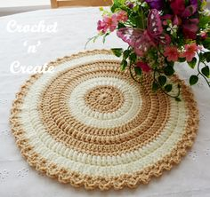 This beautiful round table mat is quick and easy to make and will look gorgeous on your dining table as a center piece or on your coffee table in your .....