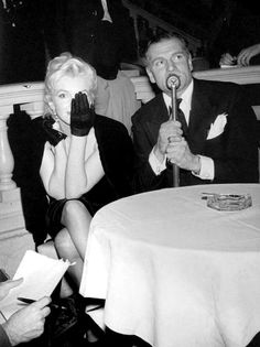 Marilyn Monroe and Laurence Olivier at a press conference at the Plaza Hotel, 1956.