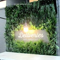 Artificial Exterior Green Wall Panel made to fit around a delivery sign