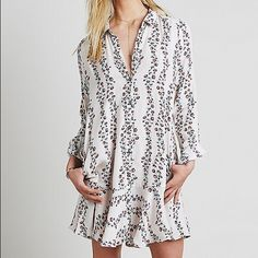 Free People button down shirt dress NWT Cute floral button down shirt dress. Color combo is called antique floral. Really it is a pale pink! Bought and never worn- it has been sitting in my closet! Free People Dresses Long Sleeve