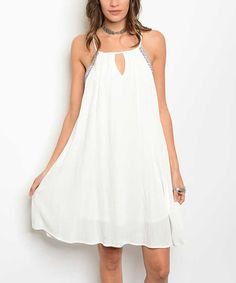 Take a look at this Ivory Geometric-Trim Keyhole Shift Dress today!