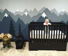 Cute mountain mural for a boy nursery