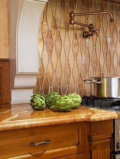 Get inspired by these one-of-a-kind backsplash photos and let your kitchen's backsplash design take center stage. Beyond basic white tiles, homeowners are incorporating metal, glass, and hand-painted tiles, as well as mixing materials to find the perfect combination for their kitchen.