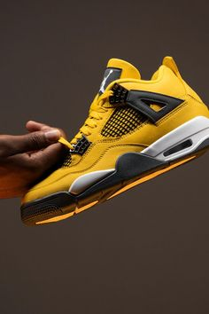 """Once part of the famed """"Thunder & Lightning"""" collection that was sold exclusively through Jordan's former website, Jumpman23.com, the Air Jordan 4 """"Lightning"""" is back via a standalone release fifteen years after its debut."""
