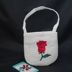 Made from creamy white textured fabric with an appliqued red rose on the front, this wristlet bag would be a cute romantic gift perhaps for Valentines Day! Red Rose Flower, Red Roses, Saint Valentine, Valentines, Satin Fabric, Cotton Fabric, Occasion Bags, Romantic Evening, Creamy White