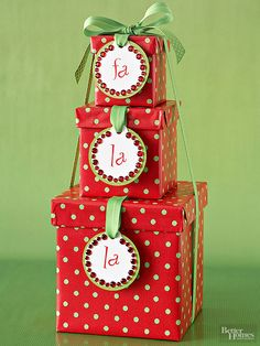 Lucky recipients will burst into song when they receive a trio of stacked gift boxes adorned with rhinestone-studded tags. Hot-glue round white tags atop green cardstock circles, then add gems around rub-on letters.