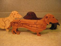 wooden dog puzzles by Teaberrywoodproducts on Etsy