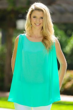 This pretty mint blouse is perfect for summer. Pair it with some white skinnies and gold sandals, and you are good to go!