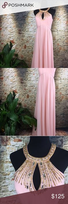 "Bariano Prom Dress, size medium. Bariano Prom Dress, size medium. Beautiful peach colored prom dress with a jeweled neck line. Measurements are neck to waist laid flat is 11"", bust is 17.5"", waist laid flat is 17"", bust to hem is 57.5"" long. Bariano Dresses Prom"