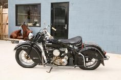 my Indian in front of our Antique Archaeology Iowa shop