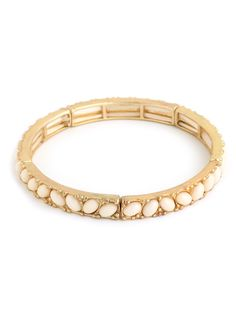 This striking bangle exudes a sophisticated, ladylike appeal while adding some cool intrigue with all that texture. Plus, the contrast of glam gold beading and those ivory cabochon gems is fantastic.
