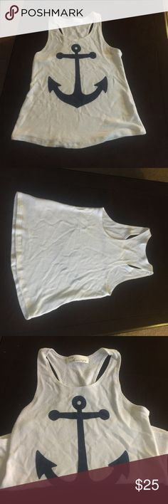 Vintage Havana tank top White tank top with navy blue anchor on front very comfortable not to form fitting a little flare on the bottom Vintage Havana Tops Tank Tops