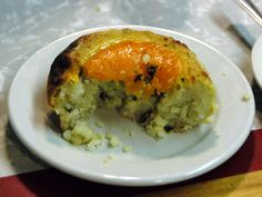 "A knish consists of a filling covered with dough that is either baked, grilled, or deep fried. Knishes can be purchased from street vendors in urban areas with a large Jewish population, sometimes at a hot dog stand or from a butcher shop.Knish (קניש) is a Yiddish word that was derived from the Ukrainian or Russian ""knysh"" (Книш), meaning dumpling or cake.The first knish bakery was founded in New York in 1910."