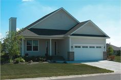 The gracious front porch gives the lovely house a homey country feel. The impressive home's 1-story floor plan has 1195 square feet of heated and cooled living space and includes 3 bedrooms.