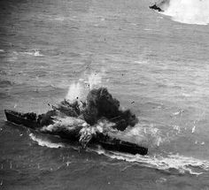 Japanese destroyer gets a direct hit from the air. Looks pretty nasty.