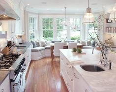 White kitchen with window seat kitchenette