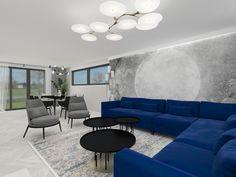 Projekt salonu z jadalnią w odcieniach szarości przełamanych intensywną niebieską kanapą. Living room with dining room.