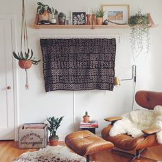 I love everything about this: the eames chair, the hanging plants and the box with vinyl <3