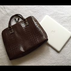 Worthington laptop bag Stunning brown snakeskin laptop bag! Pre used and is in good condition (other then the stitching undone on the outside which is sealed shut, and the bottom of one of the compartments is ripped) I love that it has multiple compartments that can hold other things in addition to your laptop! Worthington Bags Laptop Bags