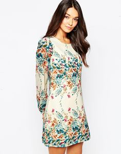 Yumi+Long+Sleeve+Shift+Dress+in+Border+Floral+Print