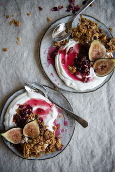 fig, rose and almond granola parfaits | two red bowls.