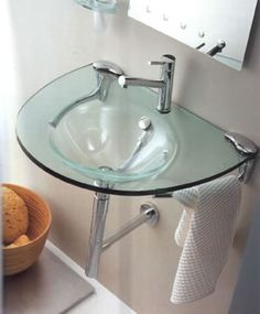 Regia 744009 glass sinks. Available with sink either on left or right hand side. Available in transparent and coloured glass versions. Chrome waste and trap. 95cm wideX57cm deepX1.9cm thick.  The chrome siphon|bottle trap, 4.5cm dia, 29cm high, is an option