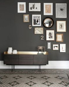 Love this corner wall collage which can be added to over time. Looks great against the darker grey wall too.