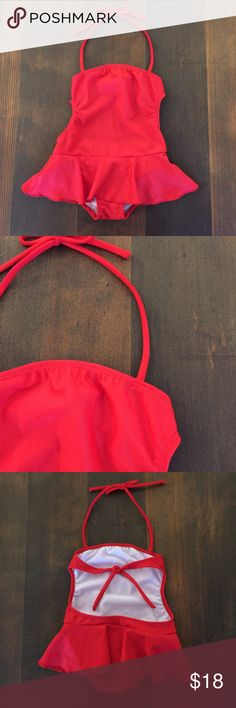 Little Akiabara Swimsuit, Size 3 Little Akiabara Swimsuit, Size 3, beautiful red one-piece bathing suit, halter ties over neck and also ties at back.  Simple ruffle skirt.  I'd intended my DD to wear it, but it runs small, so I'm listing as a 3 (not a 4/cuatro as tag reads). Brand is based in Argentina. EUC Akiabara Swim One Piece