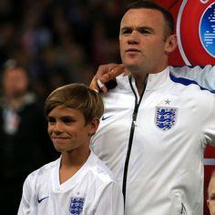 Romeo Beckham lines up with Wayne Rooney