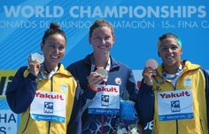 (L-R) Medallists Poliana Okimoto Cintra of Brazil (silver), Haley Anderson of USA (gold) and Ana Marcela Cunha of Brazil (bronze) pose after the Open Water Swimming Women's 5k race on day one of the 15th FINA World Championships at Moll de la Fusta on July 20, 2013 in Barcelona, Spain.