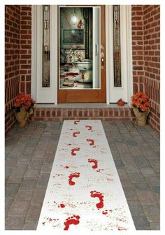 White table runner, red washable paint, paint brush for splatter...creepier if walking away from door
