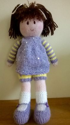 Welcome to DreamDollies, all our hand knitted dolls have their own special dream.  This is Violet. Her dream is to have a picnic in the sunshine.  She is hand knitted in acrylic wool and stuffed with 100% polyester hypo-allergenic toy stuffing. Her dress in knitted in acrylic wool with sequins. Her hair is dark brown.  She is approximately 13 inches/33 centimetres tall and her clothes are not removable.  Due to the buttons on Violets shoes and the sequins in her dress, she would not be…