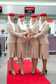 Emirates :) version of women in headscarf? Emirates Flights, Emirates Airline, Bravery Awards, Air Hostess Uniform, Flight Girls, Emirates Cabin Crew, Cheap Dresses Online, Dress Online, Traveling Teacher