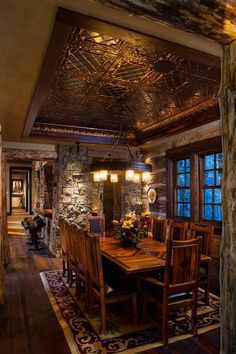 Rustic Dining Room with Hardwood floors, Stacked stone wall facade, Eldorado Stone Cut Coarse Stone, Tin ceiling panels