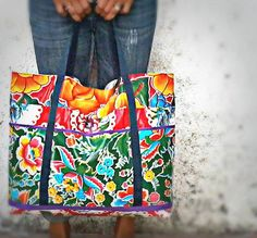 Dynamic floral patterns of Mexican oilcloth are combined in these oversize beach bags, with handy pockets and waterproof durability.