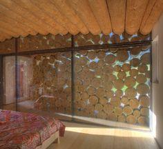 cordwood sandwiched between glass.
