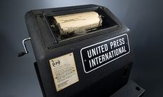 News Corporation News History Gallery: 1960s era UPI wire service machine with teletype paper in it.   Gift, Ridge Shannon    Photo credit: James P. Blair/Newseum collection