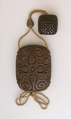 Inro, Ojime, Netsuke, early or mid-18th century  Costume/clothing accessory/waistwear, Four-case inro, carved with guri designs, in red, black and yellow lacquer; metal pouch ojime in shakudo and sentoku; square guri manju in red-brown lacquer,